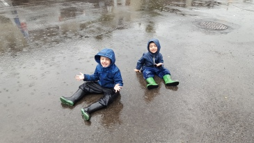 My boys, just doing what anyone would do in the rain; sit in a giant puddle.